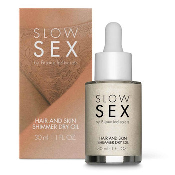 Front View of Bijoux Indiscrets Slow Sex Shimmer Dry Oil bottle and packaging on a white background