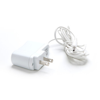An image of a coiled white wall-outlet charging cable on a white background.