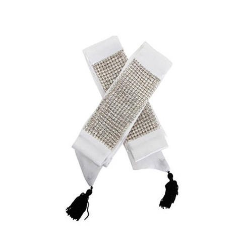 A set of white Juliette cuffs with crystals and tassels.