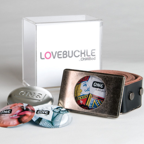 An image of the lovebuckle belt curled to the right, its box behind it, and several One condoms to the left.