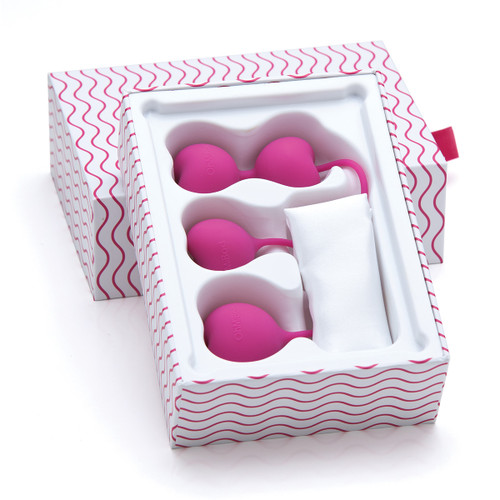 The pink silicone Lovelife Flex weights sit in their gift-ready packaging. The open box is white with a pattern of wavy pink lines.