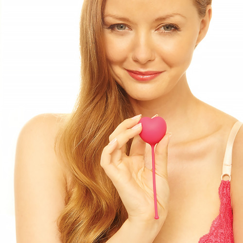 An image of a blond woman smiling at the viewer holding up one on of the Lovelife Flex weights in her hand in front of her.