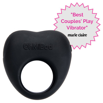 "The Lovelife Share couples vibe on a white background. It is black and heart shaped with a center opening. Beside it is a badge that reads ""best couples play vibrator"" and the logo of marie claire."