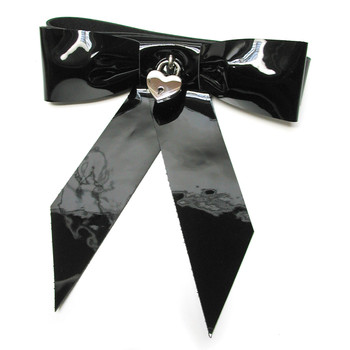 Wrist restraints shaped with a patent leather black bow sealed with a small heart shaped padlock.