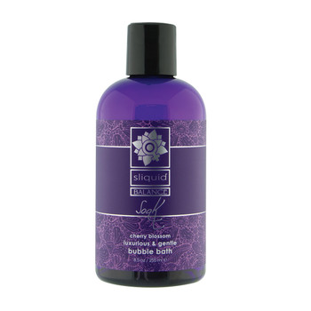 An image of a purple 8.5oz bottle of Sliquid Balance Soak bubble bath with a black cap on a white background. The fragrance is cherry blossom.