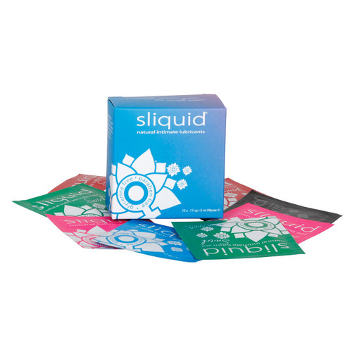 A blue box of Sliquid lubricant samples, with sample pillow packs lying around it on a white background.