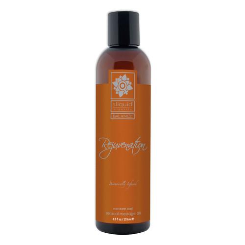 A tall brown 8.5 fluid ounce bottle of Rejuvenation massage oil by sliquid in mandarin basil. The bottle has a dark orange label.