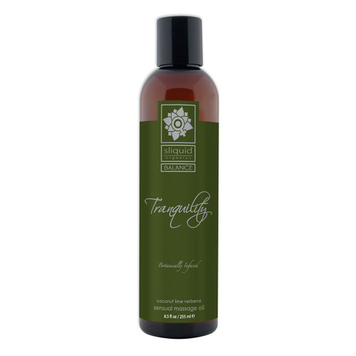 A tall brown 8.5 fluid ounce bottle of Tranquility massage oil by sliquid in coconut lime verbena. The bottle has a dark green label.