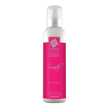 A tall clear 8.5 ounce bottle of Sliquid Smooth intimate shave cream in grapefruit thyme. The label is pink and silver, and the bottle has a white and silver pump cap.