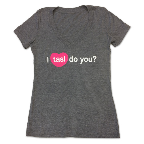 "A dark gray V-neck t-shirt with the words ""I tasl do you?"" in white lettering with tasl inside a pink heart, recreating the icon for the tasl app."